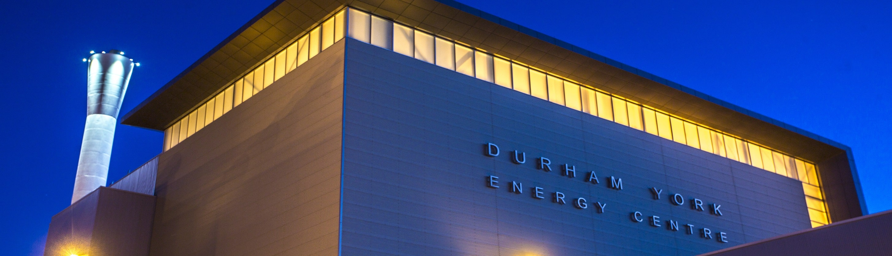 Night view of the Durham York Energy Centre sign on building