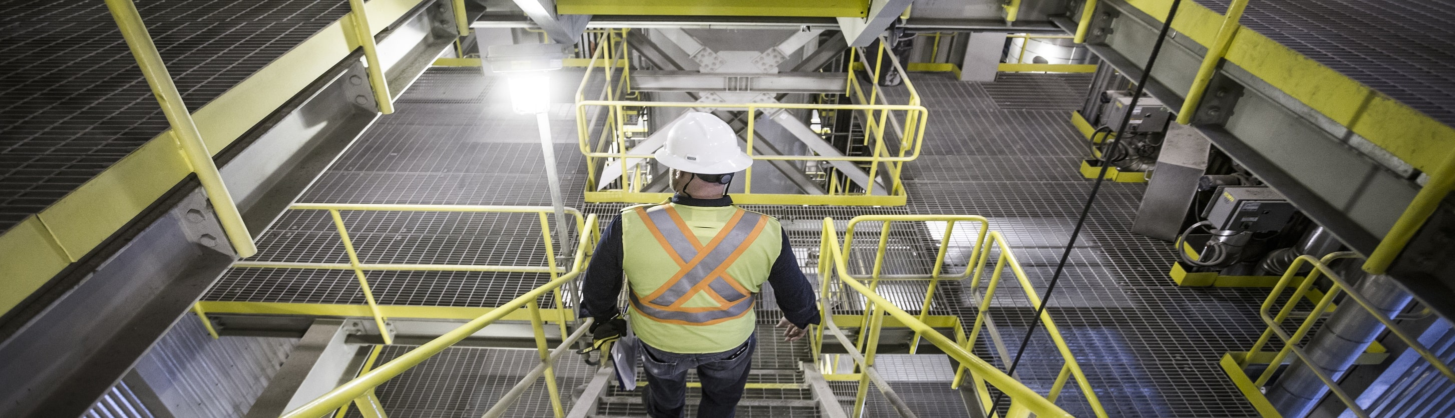 Worker walking down stairs inside the Durham York Energy Centre